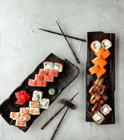 sushi rolls set covered with salmon, prawn, tuna and eel
