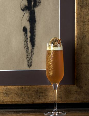 campagne glass with champagne in it garnished with dried lemon Stok Fotoğraf