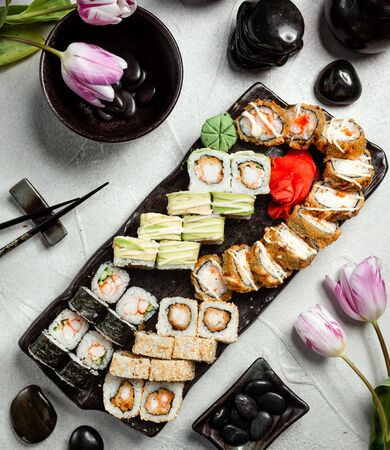 sushi rolls set with dragon roll, hot rolls, tempura rolls