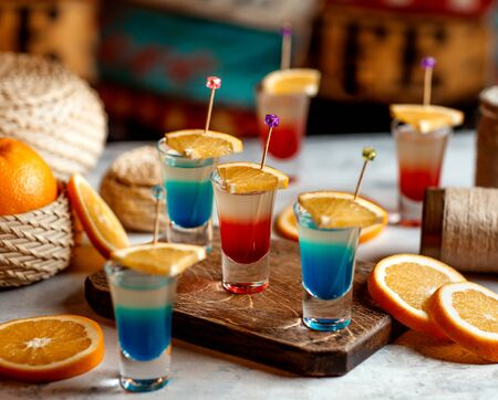glasses of shots in blue and red colours garnished with Stok Fotoğraf