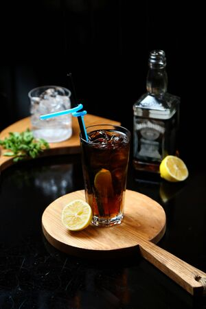 whiskey with cola on wooden board Stok Fotoğraf