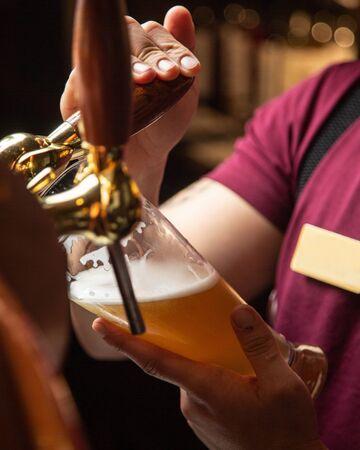 fresh light beer from barman Stok Fotoğraf