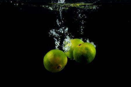 fresh three tangerines in the water Stok Fotoğraf