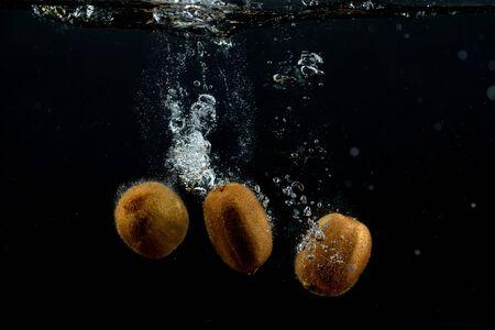 fresh kiwis in the water Stok Fotoğraf