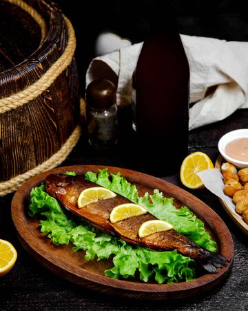 fried fish with lemon slices on the table
