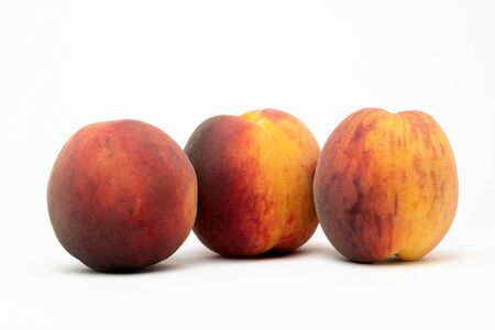 three peaches on the table
