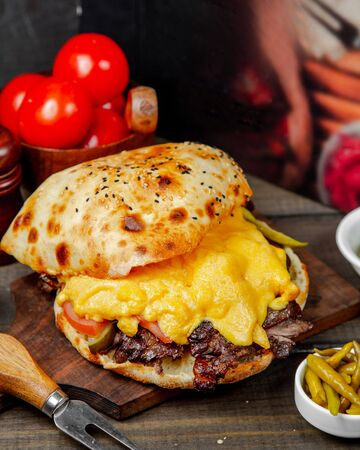 fried doner meat in the bread with cheese