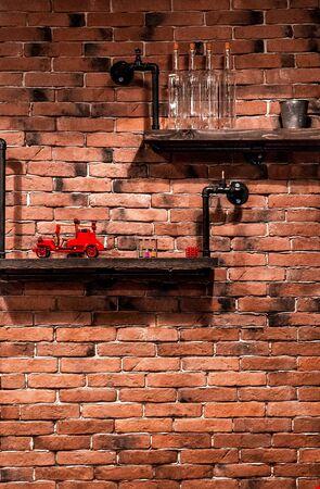 brick wall with shelfs on it