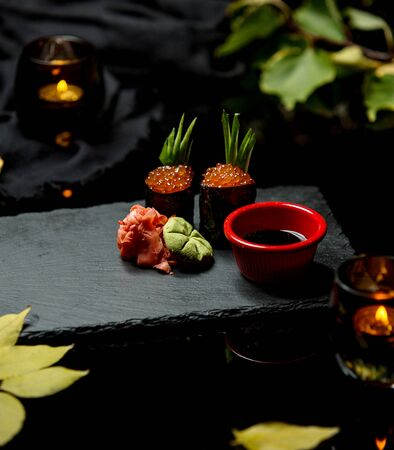 sushi with red caviar ginger horseradish and soy sauce Stock Photo