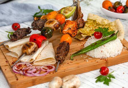 meat kebab on a skew with vegetables