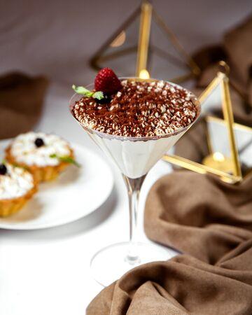 italian tiramisu in martini glass topped with coffee sprinkles and