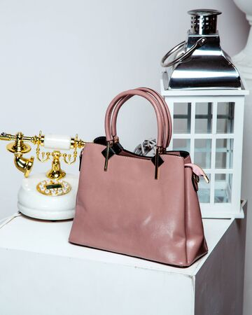pink leather bag with short handles