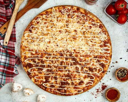 meat pizza with half covered in extra grated cheese Banco de Imagens