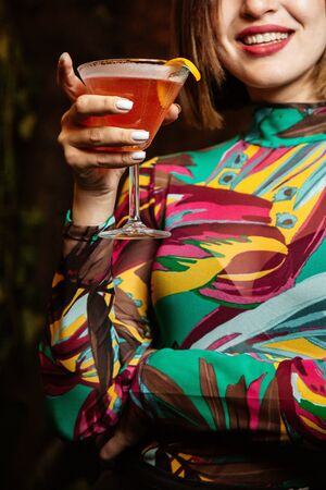 woman holding fruit cocktail in her hands Stok Fotoğraf - 134747538