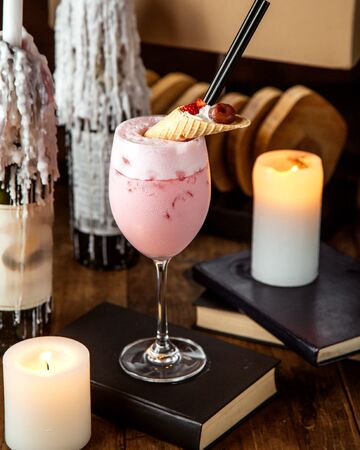 strawberry milkshake topped with dessert