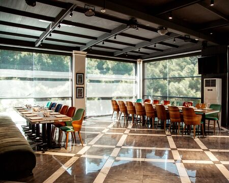 restaurant with a beautiful view of the forest Stok Fotoğraf - 134747543