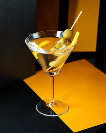 a beverage with olives on stick Stok Fotoğraf