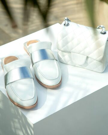 white shoes with white hand bag Stok Fotoğraf