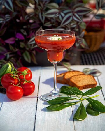 tomato juice with cheese and herbs Stok Fotoğraf - 134747645