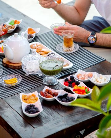 set with lots of sweets with black tea Stok Fotoğraf - 134747651