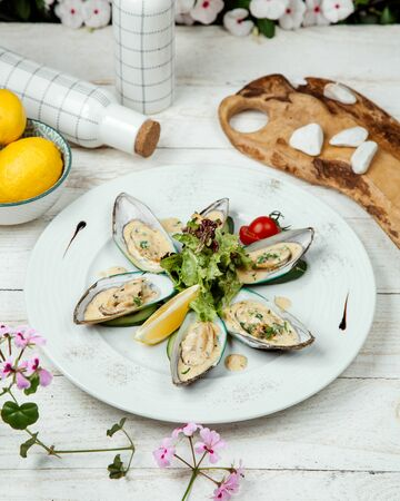 oysters in sour cream sauce and herbs