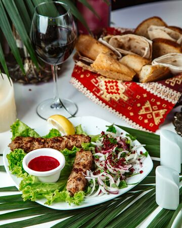 lule kebab with glass of red wine Stok Fotoğraf - 134747657
