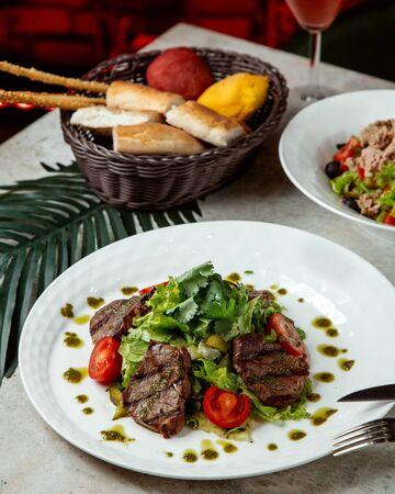 vegetable salad with fried sliced meat Stok Fotoğraf