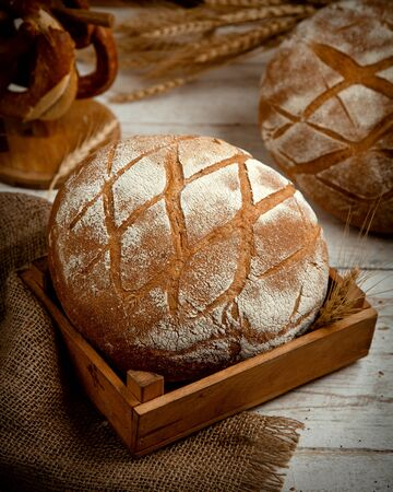 loaf of bread topped with flour _ Stok Fotoğraf - 134747574