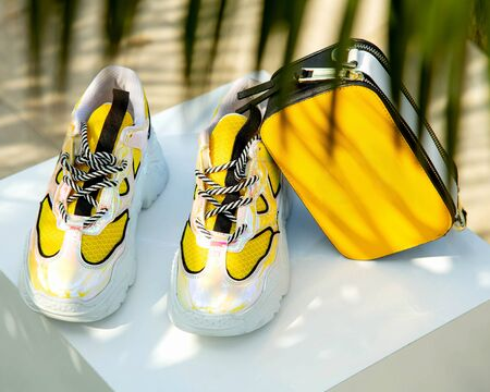 yellow sneakers with small yellow bag