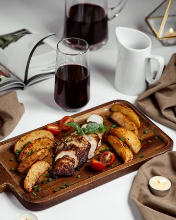 meat slices and fried potato topped with herbs Stok Fotoğraf - 134747514