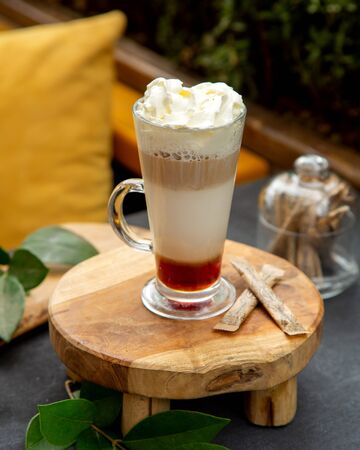 multiple layer coffee cocktail topped with whipped cream