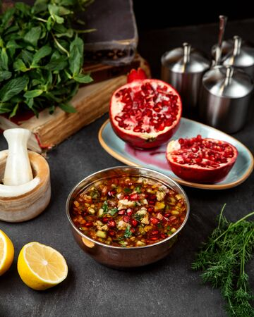 vegetable soup topped with pomegranate Stok Fotoğraf - 134747436