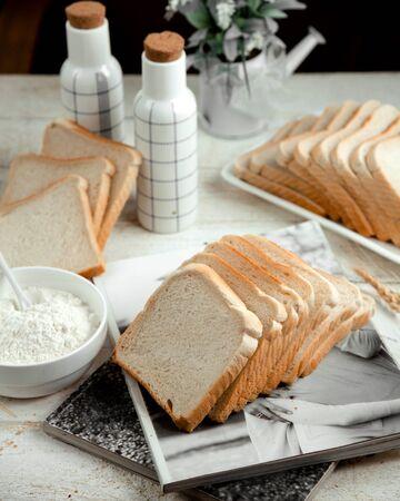 sliced white bread with sour cream Stok Fotoğraf - 134747458