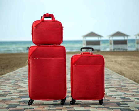 set of red suitcases and bags