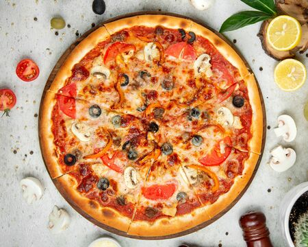 mixed pizza with sliced lemon