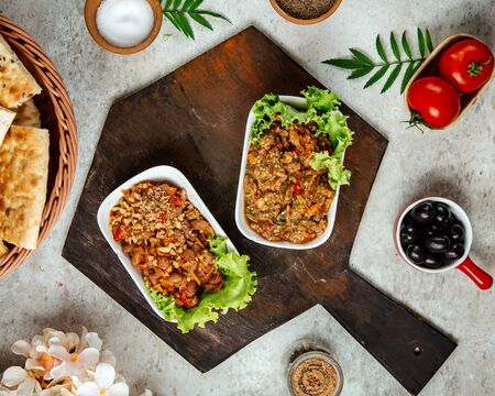 barbecue salad and salad with beans on a wooden board
