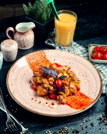 chicken in tomato sauce with colored bell peppers