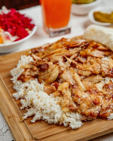 chicken doner kebab served with rice