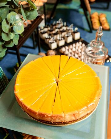 round, orange pie cut into triangular pieces