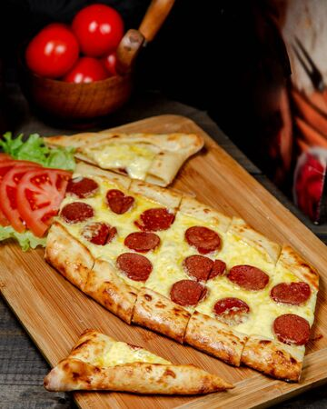 pide with cheese and sausages