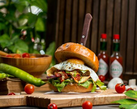 beef burger with egg lettuce tomato and onion