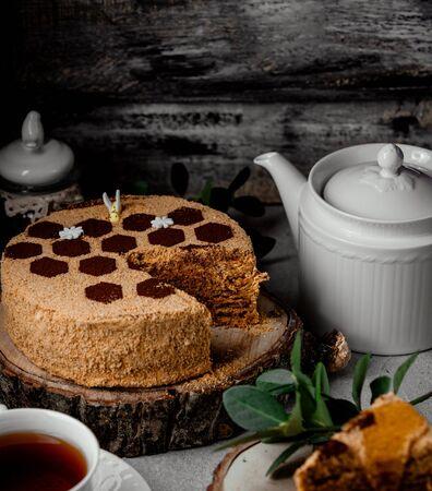 honey cake decorated with coffee in honey beehive hexagonal shape