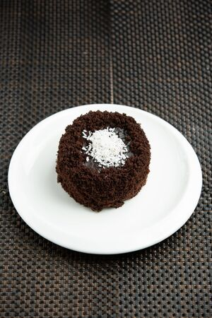 portioned chocolate cake with coconut sprinkles