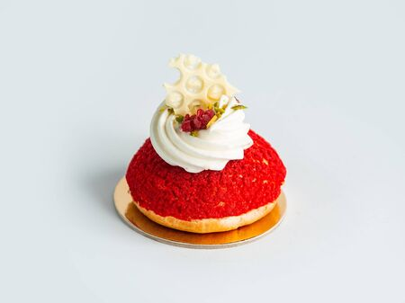red mountain cookie garnished with cream raspberry and pistachio