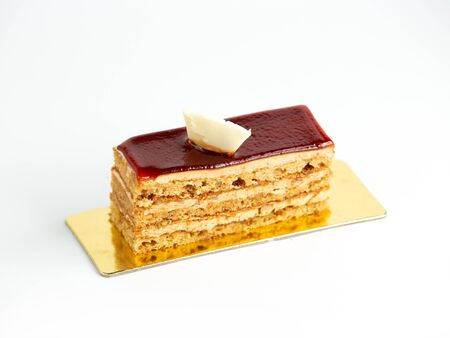 portioned layered cake topped with cherry glaze