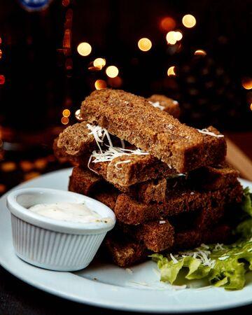 garlic toasts with sour cream sauce 版權商用圖片