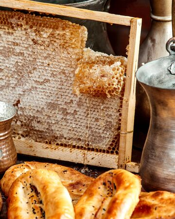 honeycombs with loafs of bread