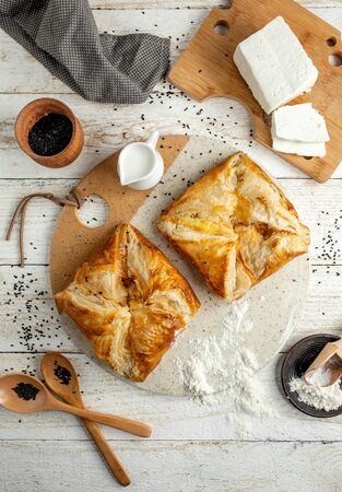 khachapuri with side sliced white cheese