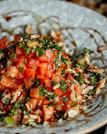 mixed salad with chopped tomato and herbs