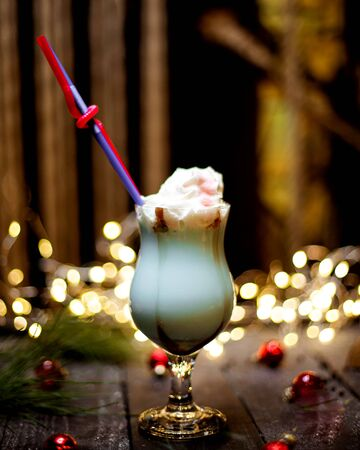 milkshake in glass with whipped cream